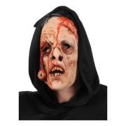 Blodig mask med hängande öga